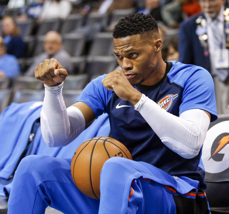 Photo - Oklahoma City's Russell Westbrook (0) dances in a chair on the bench to a song playing before an NBA basketball game between the Oklahoma City Thunder and the New Orleans Pelicans at Chesapeake Energy Arena in Oklahoma City, Monday, Nov. 5, 2018. Photo by Nate Billings, The Oklahoman