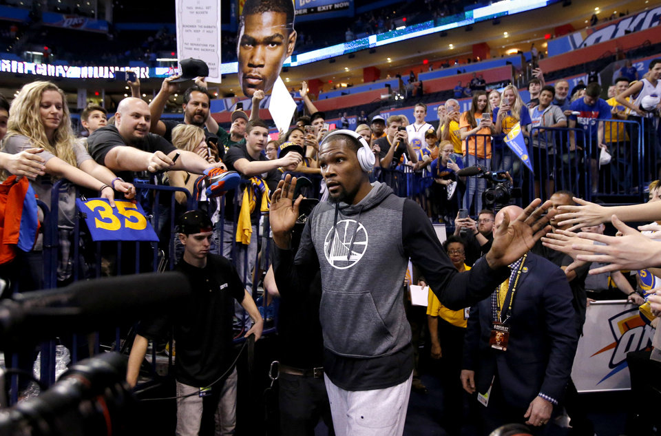 sale retailer 97fde 3b9ab Golden State s Kevin Durant walks towards the court to warm up before an  NBA basketball game between the Oklahoma City Thunder and the Golden State  Warriors ...