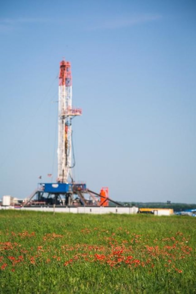Photo -  A rig drills Chesapeake Energy's Brown 1H-E well in its Brazos Valley operational area. The company acquired a significant amount of holdings in the Eagle Ford Shale field when it bought WildHorse Resource Development Corp. in January.