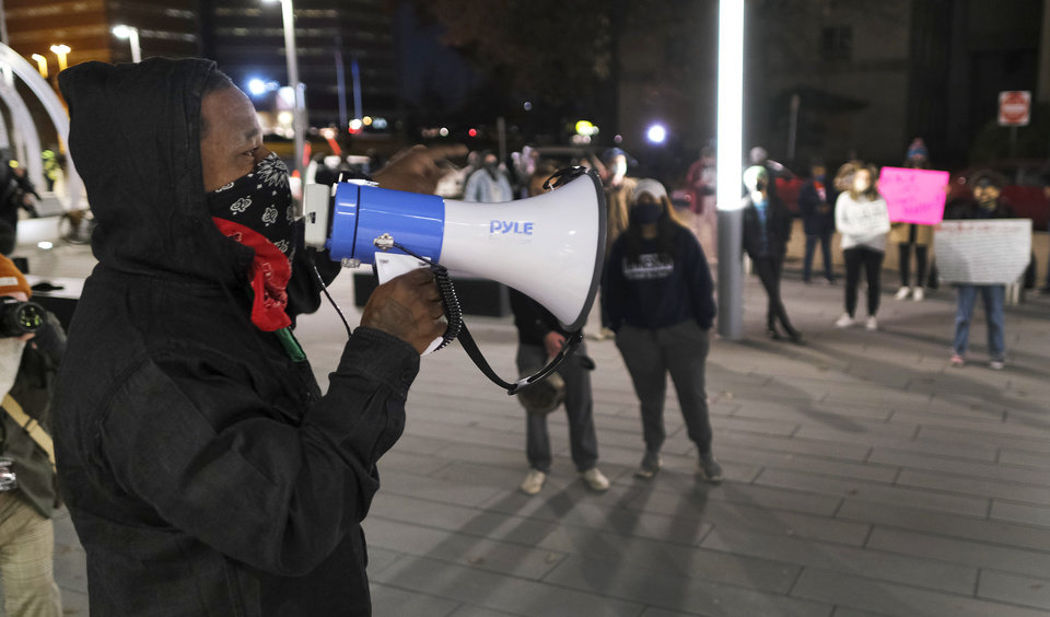 Photo - Jabee Williams speaks as BLM holds a protest rally at the Oklahoma City Police Headquarters, then marched to the Oklahoma County Courthouse, then finally to the Oklahoma City Municipal Court Building Friday night in response to OCPD officers  shooting and killing a Black man in a northwest Oklahoma City parking lot at Penn and Hefner Friday morning, December 11, 2020. [Doug Hoke/The Oklahoman]