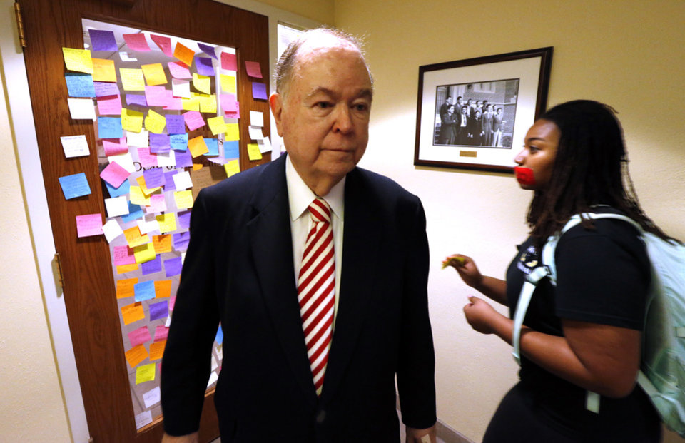 Photo - University of Oklahoma President David L. Boren joins students in placing messages on sticky notes onto the entry of the office of student affairs as students protest racist comments made by a fraternity on March 9, 2015 in Norman, Okla. Photo by Steve Sisney, The Oklahoman
