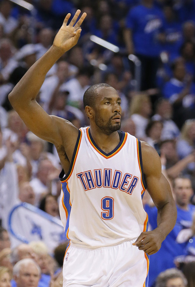 Photo - Oklahoma City's Serge Ibaka (9) celebrates after a basket during Game 3 of the Western Conference finals in the NBA playoffs between the Oklahoma City Thunder and the Golden State Warriors at Chesapeake Energy Arena in Oklahoma City, Sunday, May 22, 2016. Oklahoma City won 133-105. Photo by Bryan Terry, The Oklahoman