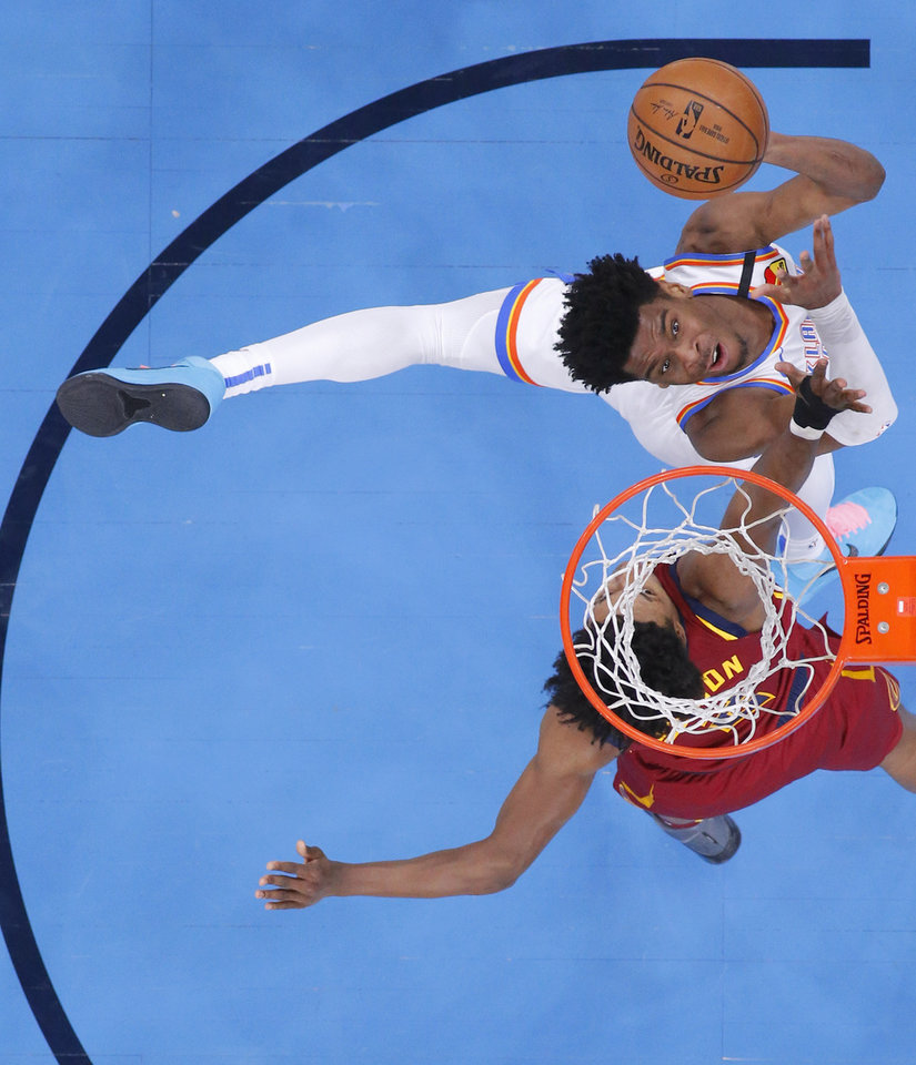 Photo - Oklahoma City's Shai Gilgeous-Alexander (2) puts up a shot beside Cleveland's Collin Sexton (2) during an NBA basketball game between the Oklahoma City Thunder and the Cleveland Cavaliers at Chesapeake Energy Arena in Oklahoma City, Wednesday, Feb. 5, 2020. Oklahoma City won 109-103. [Bryan Terry/The Oklahoman]