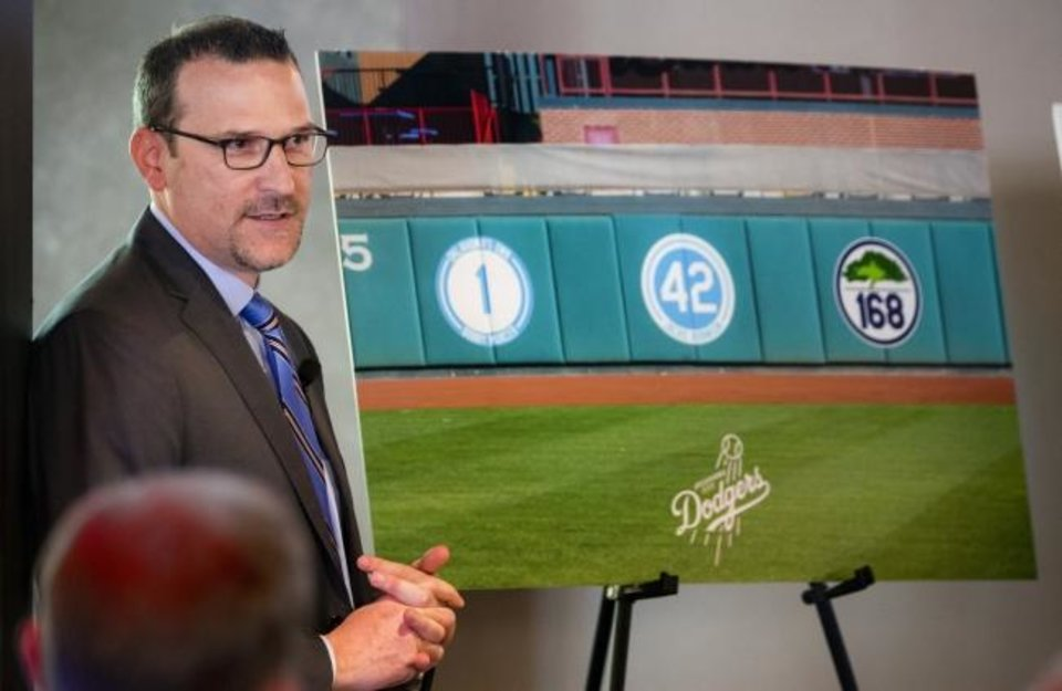 Photo -  OKC Dodgers president and general manager Michael Byrnes talks Tuesday about the No. 168 team jersey the team will retire this season in honor of the lives lost in the 1995 Oklahoma City bombing. [Chris Landsberger/The Oklahoman]