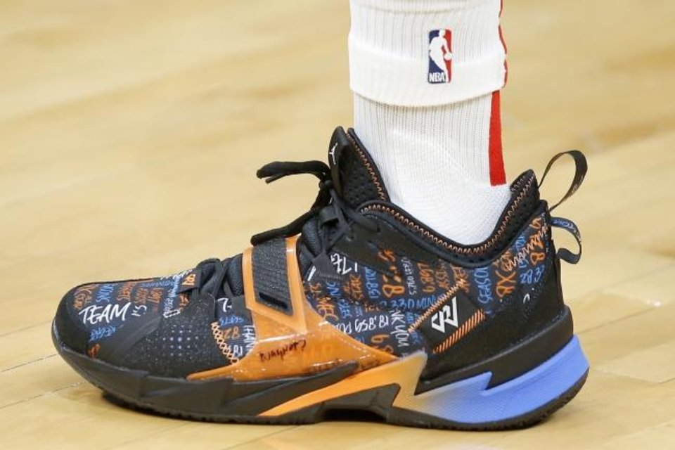 Photo -  Houston's Russell Westbrook wore custom sneakers during Thursday night's game against Oklahoma City. The black, orange and blue sneakers featured stats from his 11 seasons in OKC. [Bryan Terry/The Oklahoman]