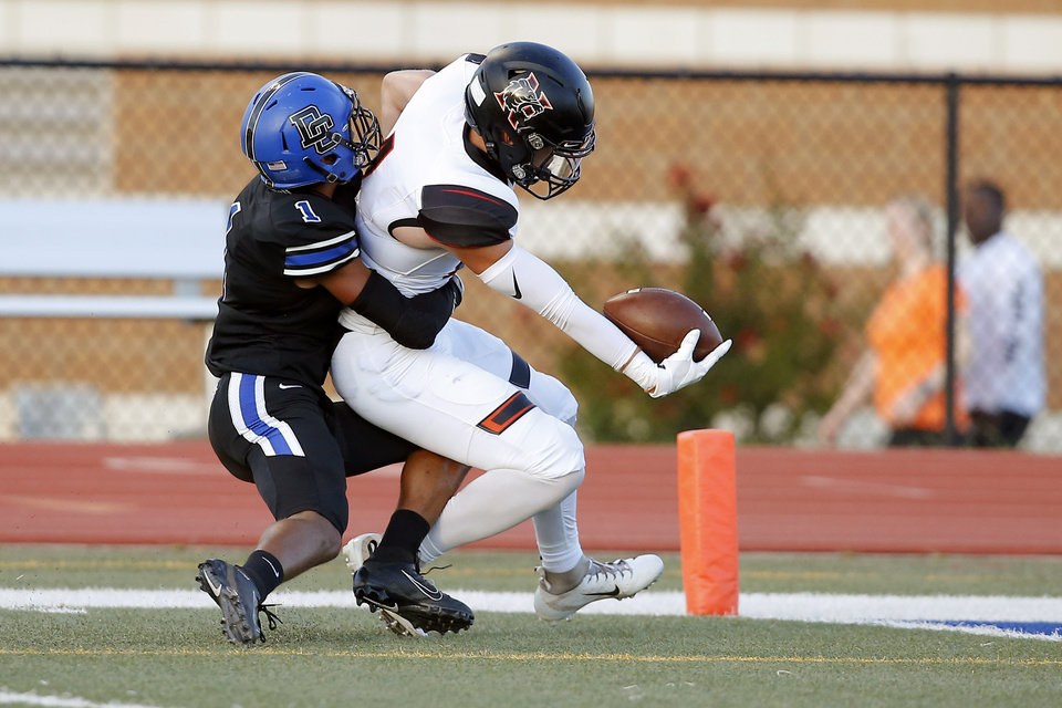 Photo - Norman's Jonah Paden reaches for the end zone to score a touchdown as Deer Creek's Jevion Jones tries to bring him down during a high school football game between Deer Creek and Norman at Deer Creek High School, Friday, Sept. 13, 2019. [Bryan Terry/The Oklahoman]