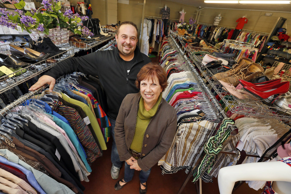 Photo - Jace Kirk and Sally Goin stand in an aisle at the new Shidler-Wheeler Community Thrift Store, 735 SE 15 opened by FaithWorks of the Inner City.   NATE BILLINGS - NATE BILLINGS