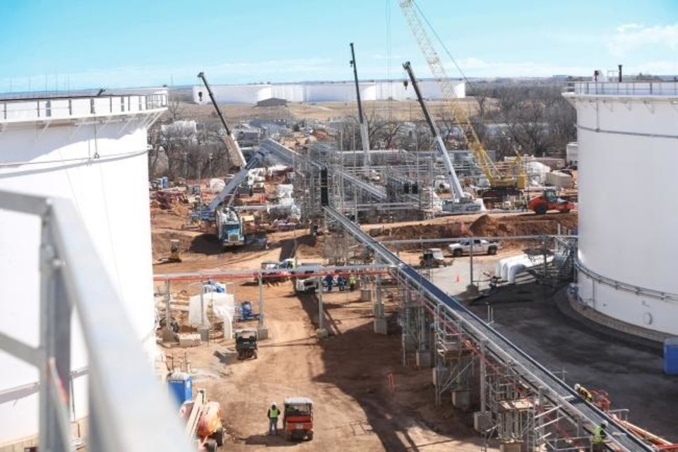 Photo -  Matrix Service Co. builds tanks at the Cushing terminal in Oklahoma. Companies that operate the terminal have dramatically grown their ability to store crude oil there the past decade.