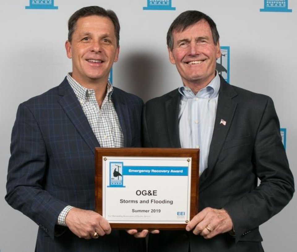 Photo -  Sean Trauschke, left, CEO of OGE Energy, accepts an Emergency Recovery Award from Tom Kuhn, president of the Edison Electric Institute, at the institute's winter meeting. Oklahoma Gas and Electric Co. received two of the awards, recognizing it for outstanding work it did to restore service to customers impacted by severe weather events in 2019. [PROVIDED]