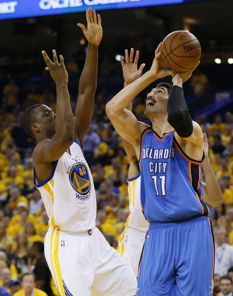 Photo - Oklahoma City's Enes Kanter (11) shoots beside Golden State's Harrison Barnes (40) during Game 2 of the Western Conference finals in the NBA playoffs between the Oklahoma City Thunder and the Golden State Warriors at Oracle Arena in Oakland, Calif., Wednesday, May 18, 2016. Photo by Nate Billings, The Oklahoman
