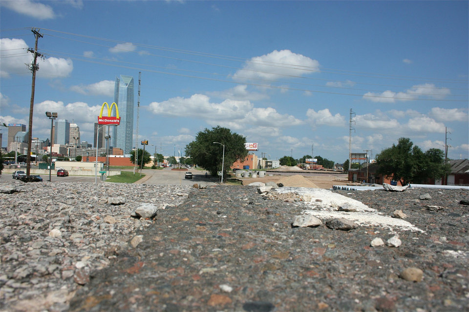 Photo - State highway engineers are faing criticism for plans to extend the future boulevard at Western Avenue, the path of which is shown in this photo, at an elevation east toward Lee Avenue.  provided