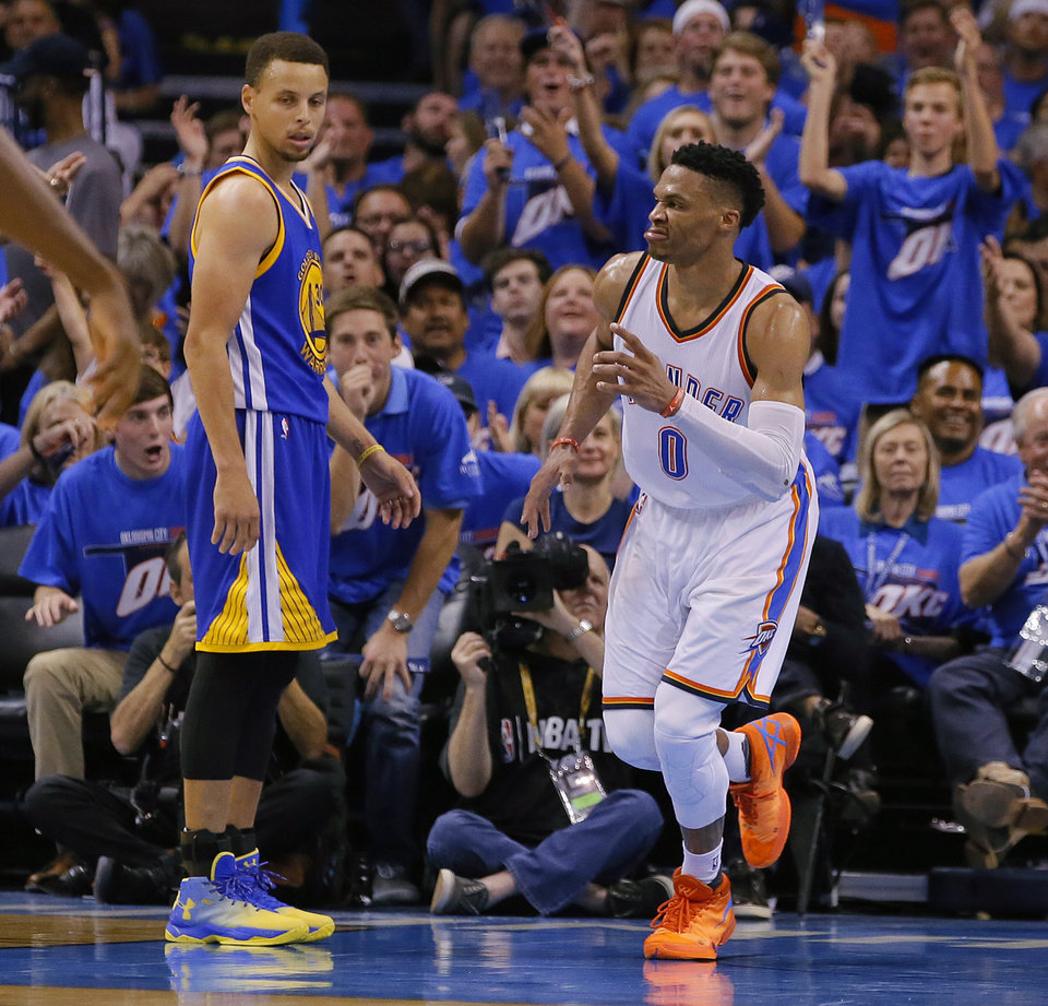 Photo - Oklahoma City's Russell Westbrook (0) celebrates beside Golden State's Stephen Curry (30) during Game 3 of the Western Conference finals in the NBA playoffs between the Oklahoma City Thunder and the Golden State Warriors at Chesapeake Energy Arena in Oklahoma City, Sunday, May 22, 2016. Oklahoma City won 133-105. Photo by Bryan Terry, The Oklahoman