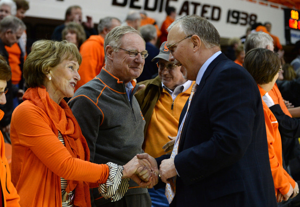 Photo - OSU President Burns Hargis and First Lady Ann Hargis congratulate Coach Jim Littell for a win after a Big 12 women's basketball game between Oklahoma State and Texas on Wednesday Feb. 11 in Gallagher-Iba arena in Stillwater. JACKIE DOBSON/ for The Oklahoman