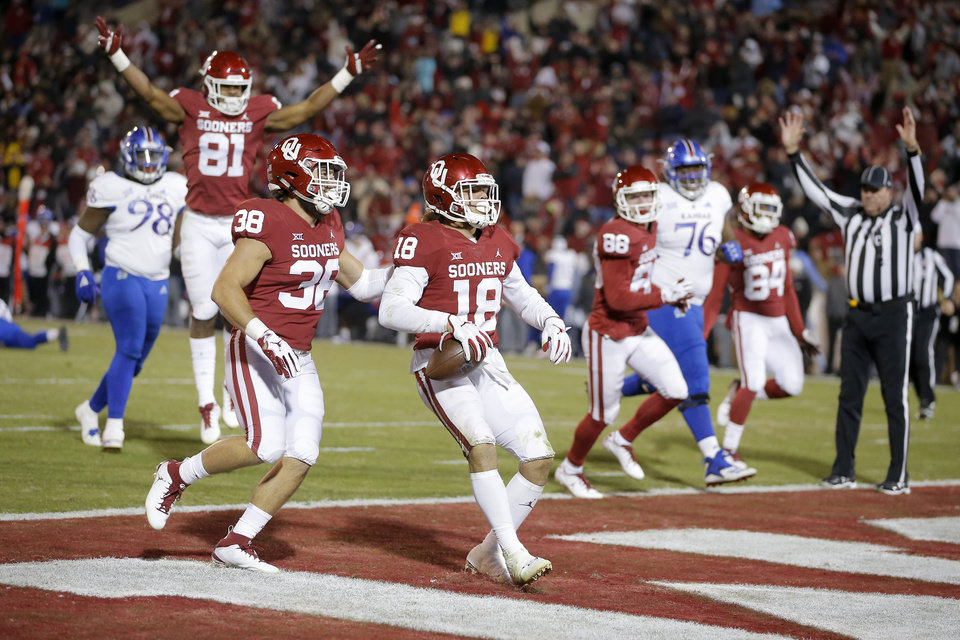 Photo - Oklahoma's Curtis Bolton (18) returns a blocked kick for a touchdown beside Bryan Mead (38) during a college football game between the University of Oklahoma Sooners (OU) and the Kansas Jayhawks (KU) at Gaylord Family-Oklahoma Memorial Stadium in Norman, Okla., Saturday, Nov. 17, 2018. Photo by Bryan Terry, The Oklahoman