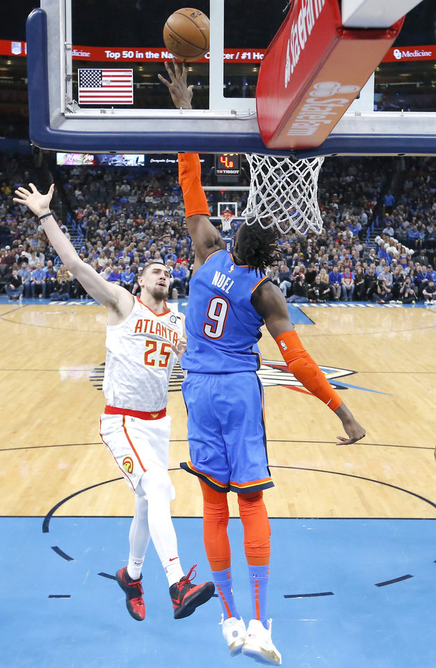 Photo - Oklahoma City's Nerlens Noel (9) defends against Atlanta's Alex Len (25) during the NBA basketball game between the Oklahoma City Thunder and the Atlanta Hawks at the Chesapeake Energy Arena in Oklahoma City,Friday, Jan. 24, 2020.  [Sarah Phipps/The Oklahoman]