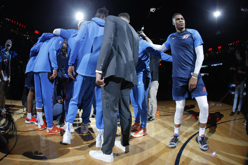 Photo - Oklahoma City's Russell Westbrook gathers with the Thunder before an NBA basketball game between the Oklahoma City Thunder and the Sacramento Kings at Chesapeake Energy Arena in Oklahoma City, Sunday, Oct. 21, 2018. Photo by Bryan Terry, The Oklahoman