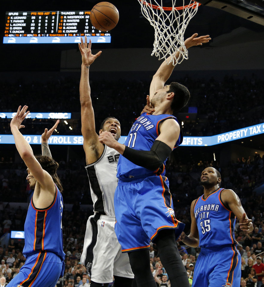 Photo - Oklahoma City's Enes Kanter (11) blocks the shot of San Antonio's Tim Duncan (21) beside Steven Adams (12) and Kevin Durant (35) during Game 5 of the second-round series between the Oklahoma City Thunder and the San Antonio Spurs in the NBA playoffs at the AT&T Center in San Antonio, Tuesday, May 10, 2016. Oklahoma City won 95-91. Photo by Bryan Terry, The Oklahoman