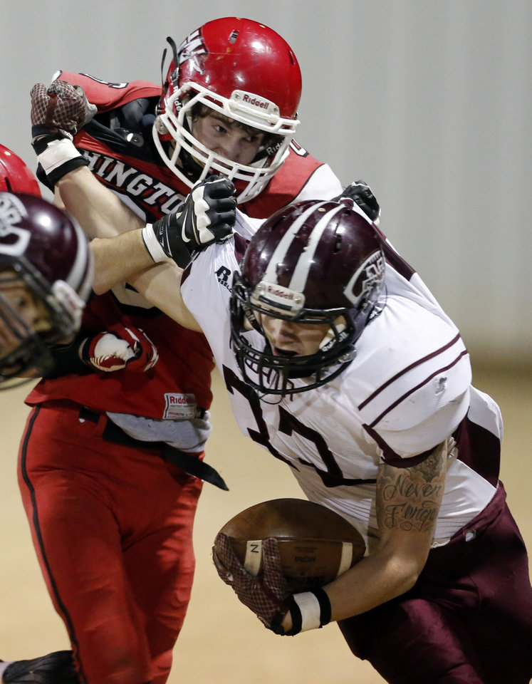 Photo - Washington's R. J. Vaughn forces Corey Hobbs out of bounds as the Nowata Ironmen play the Washington Warriors in high school football on Friday, Nov. 28, 2014 in Washington, Okla. Photo by Steve Sisney, The Oklahoman