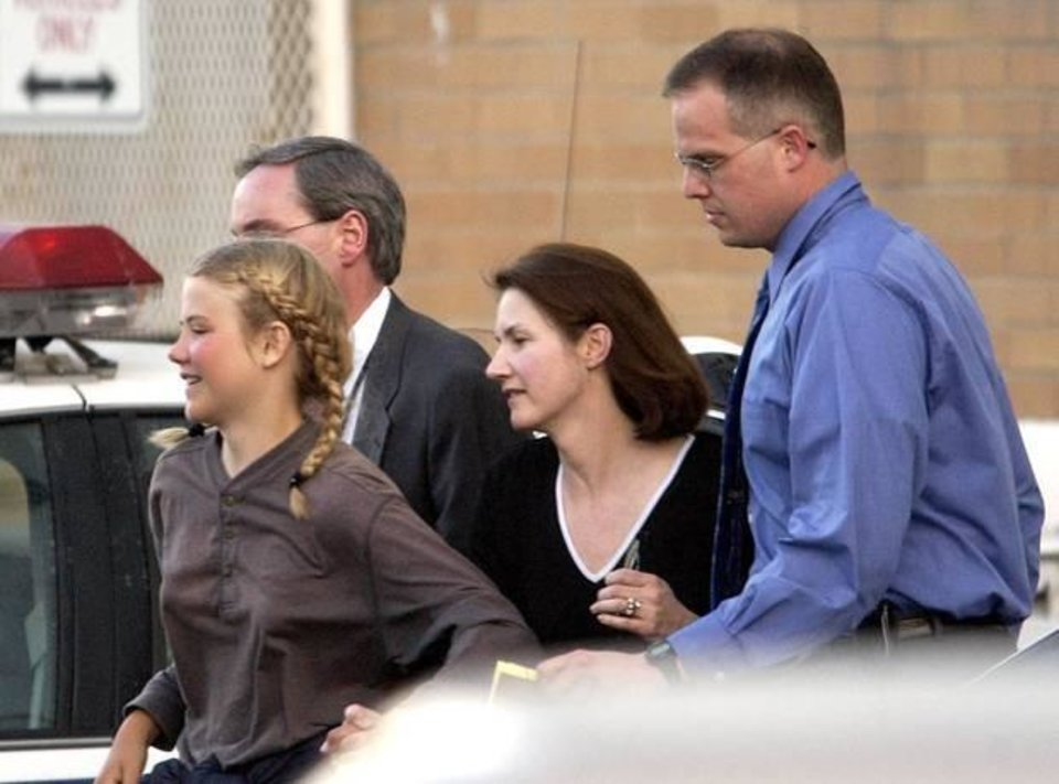 Photo - In this March 12, 2003, file photo, Elizabeth Smart is rushed into an unmarked van from the Salt Lake City Police department and taken to her home, in Salt Lake City. More than a decade after her kidnapping and rescue grabbed national headlines, Elizabeth Smart published a memoir of her ordeal,