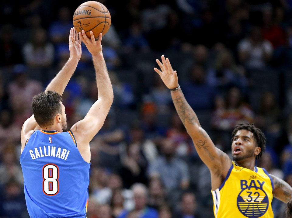 Photo - Oklahoma City's Danilo Gallinari (8) shoots a 3-point basket as Golden State's Marquese Chriss (32) defends during the NBA game between the Oklahoma City Thunder and the Golden State Warriors at Chesapeake Energy Arena,   Saturday, Nov. 9, 2019.  [Sarah Phipps/The Oklahoman]