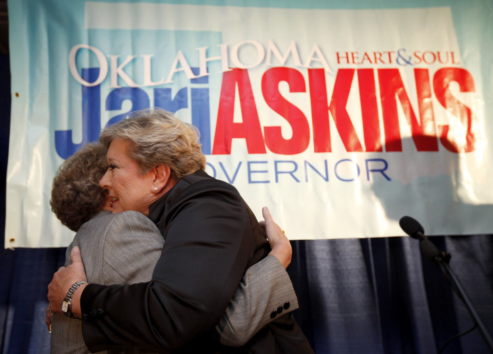 Photo - Democratic candidate for governor Jari Askins receives a hug after giving a concession speech during a watch party in Oklahoma City on Tuesday, Nov. 2, 2010. Photo by Bryan Terry, The Oklahoman