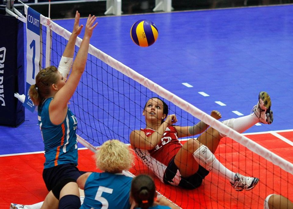 Photo -  USA / UNITED STATES / U.S./ UNIVERSITY OF CENTRAL OKLAHOMA / WOMEN: Kendra Lancaster lies on her back and watchs the ball she hit. The Sitting Volleyball World Championships took place at UCO on Saturday July 17, 2010. Photo by Mitchell Alcala, The Oklahoman  ORG XMIT: KOD