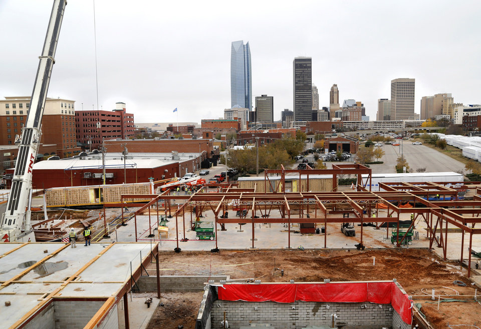 Photo -  The downtown skyline is seen from atop the future AC Hotel being built in east Bricktown. [Photo by Jim Beckel, The Oklahoman]