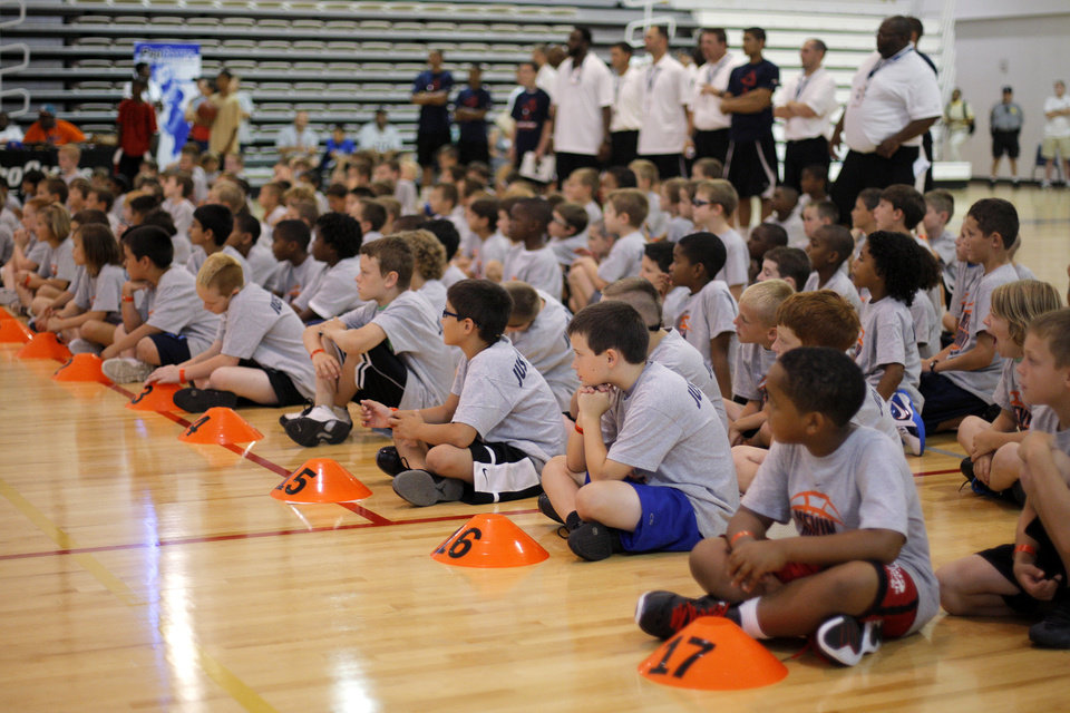 Photo - Children await instruction during the Kevin Durant basketball camp at Heritage Hall Wednesday, June 29, 2011.  Photo by Garett Fisbeck, The Oklahoman