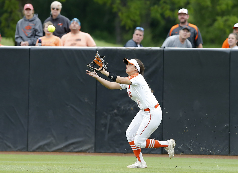 Photo - Oklahoma State's Chyenne Factor (9) catches the ball for an out in the fifth inning of the Stillwater Regional NCAA softball tournament game between Oklahoma State University (OSU) and Tulsa in Stillwater, Okla., Saturday, May 18, 2019. Oklahoma State won 2-1. [Bryan Terry/The Oklahoman]