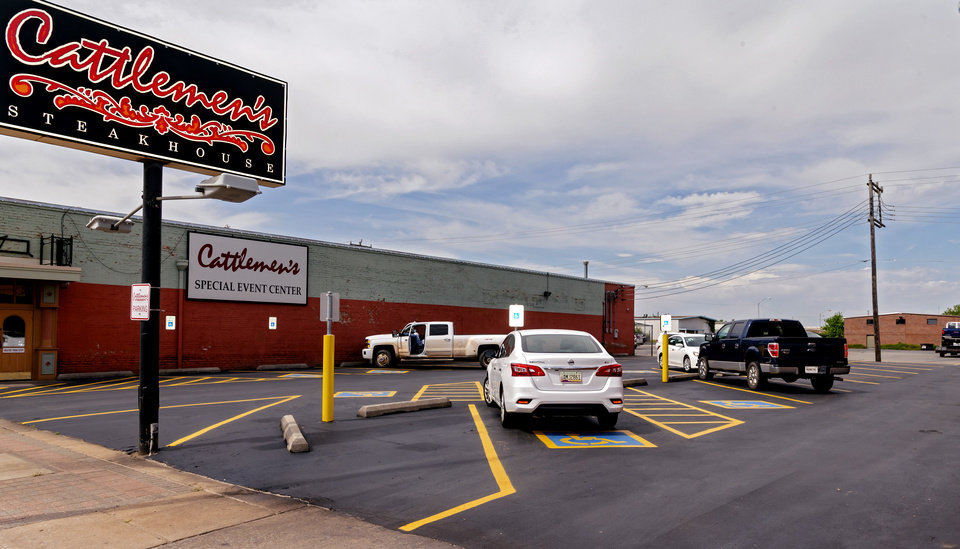 Photo - Cars begin to fill the parking lot at Cattlemen's Steakhouse in Oklahoma City, Okla. on Friday, May 1, 2020, as Cattlemen's and other restaurants begin their gradual reopening on Friday after being closed due to the Coronavirus Pandemic.[Chris Landsberger/The Oklahoman]