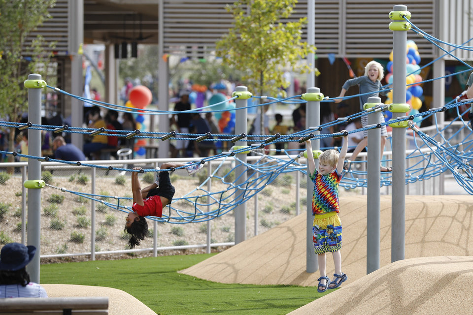 Photo - Kids enjoy the playground during the grand opening weekend of Scissortail Park in Oklahoma City, Sunday, Sept. 29, 2019. (Alonzo Adams for The Oklahoman)