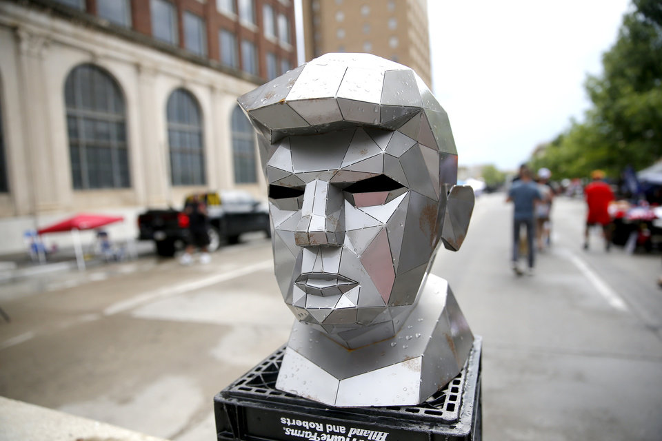 Photo - A bust of Trump sits on a barricade near the camps of Trump supporters in downtown Tulsa, Okla., ahead of President Donald Trump's Saturday campaign rally, Friday, June 19, 2020. [Sarah Phipps/The Oklahoman]