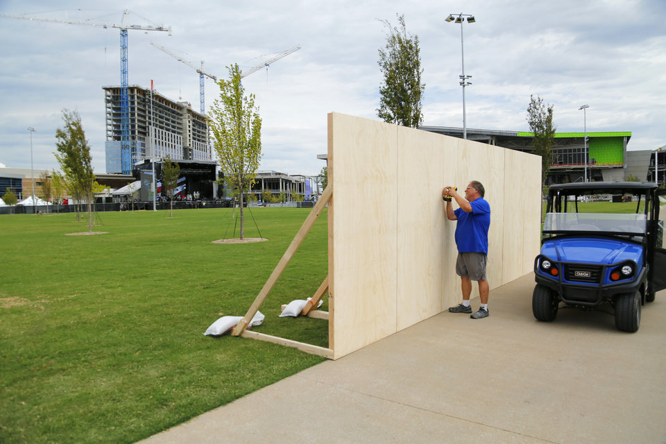 Photo - Plywood set up for murals. Preparations are wrapping up for the opening night Kings of Leon concert to kick off the grand opening weekend of Scissortail Park Thursday, September 26, 2019. [Doug Hoke/The Oklahoman]
