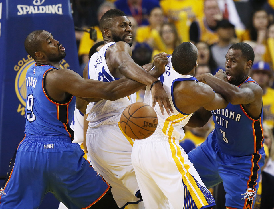 Photo - From left, Oklahoma City's Serge Ibaka (9), Golden State's Festus Ezeli (31), Golden State's Harrison Barnes (40) and Oklahoma City's Dion Waiters (3) fight for position after Ezeli blocked a shot by Waiters in the fourth quarter during Game 2 of the Western Conference finals in the NBA playoffs between the Oklahoma City Thunder and the Golden State Warriors at Oracle Arena in Oakland, Calif., Wednesday, May 18, 2016. Golden State won 118-91. Photo by Nate Billings, The Oklahoman