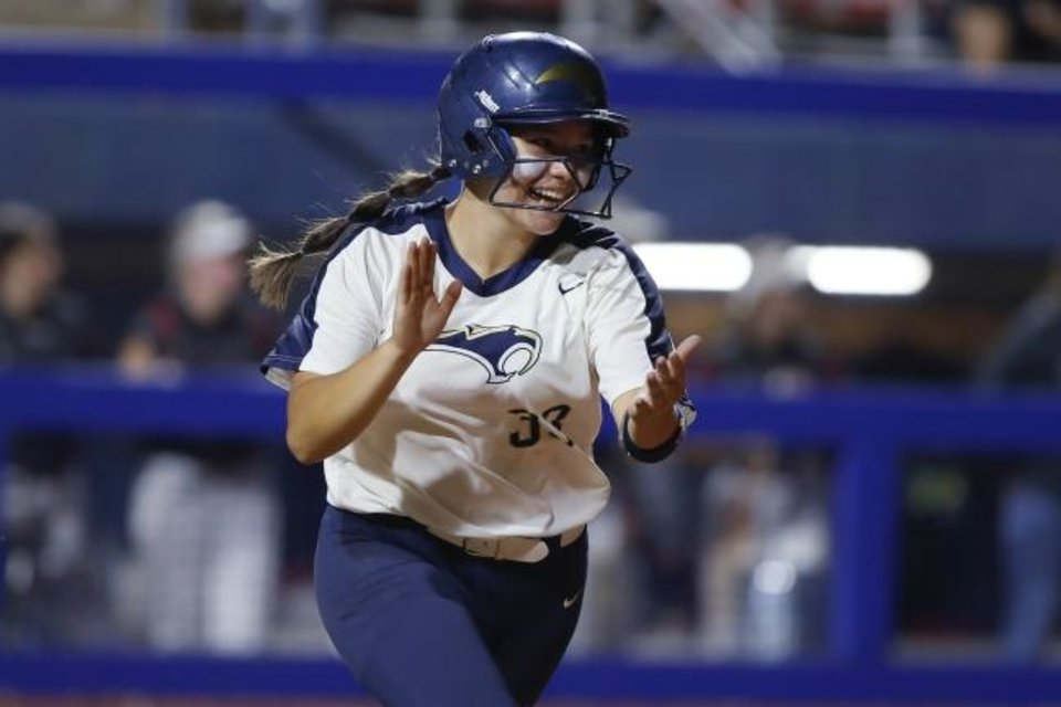 Photo -  Southmoore's Brinly Maples celebrates after a hit during the Class 6A state softball championship game against Owasso at USA Softball Hall of Fame Stadium on Oct. 17. [Bryan Terry/The Oklahoman]