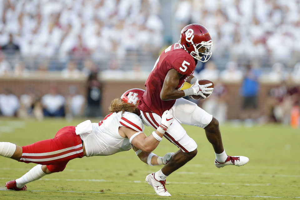 Photo - Oklahoma's A.D. Miller (5) runs past Houston's Grant Stuard (3) during a college football game between the University of Oklahoma Sooners (OU) and the Houston Cougars at Gaylord Family-Oklahoma Memorial Stadium in Norman, Okla., Sunday, Sept. 1, 2019. Oklahoma won 49-31. [Bryan Terry/The Oklahoman]