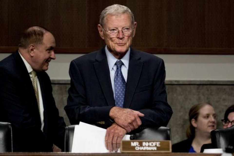 Photo -  Sen. Jim Inhofe arrives for a Senate Armed Services Committee meeting in July. [AP Photo/Andrew Harnik]