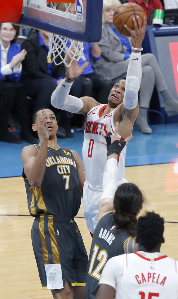 Photo - Houston's Russell Westbrook (0) goes to the basket beside Oklahoma City's Darius Bazley (7) during an NBA basketball game between the Oklahoma City Thunder and Houston Rockets at Chesapeake Energy Arena in Oklahoma City, Thursday, Jan. 9, 2020. [Bryan Terry/The Oklahoman]