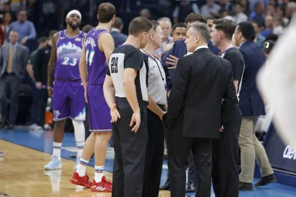Photo -  Thunder coach Billy Donovan meets with officials on March 11 before the OKC-Utah game was postponed at Chesapeake Energy Arena. [Bryan Terry/The Oklahoman]