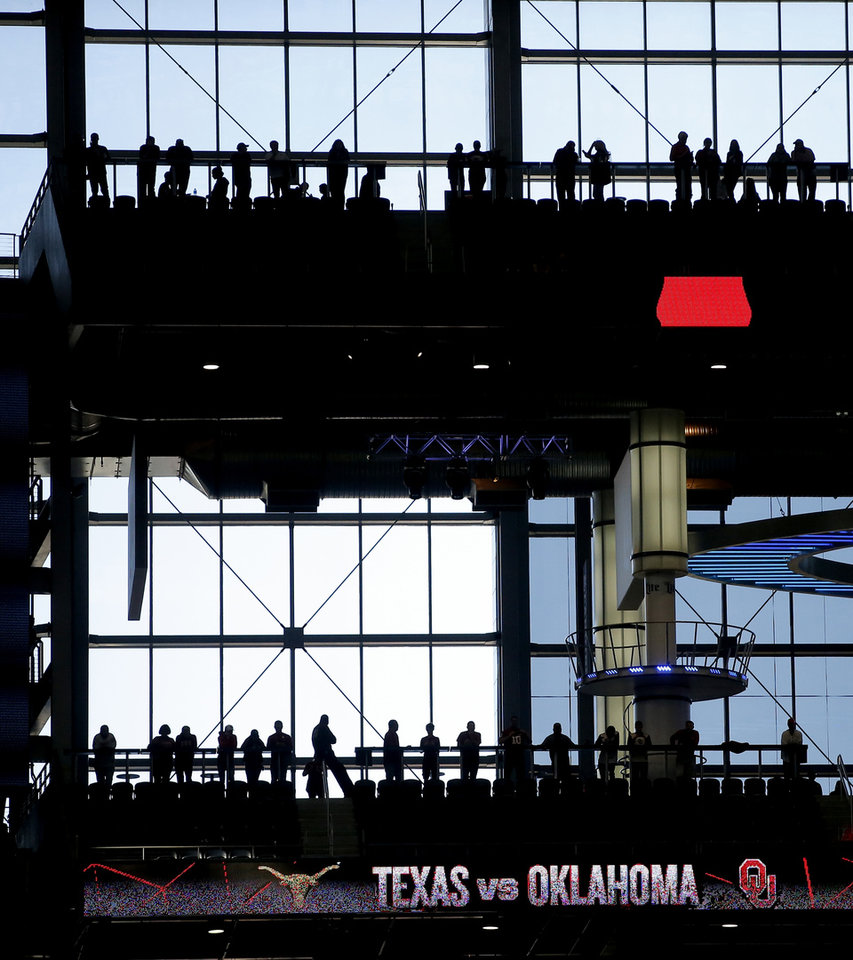 Photo - Fans wait for the start of the Big 12 Championship football game between the Oklahoma Sooners (OU) and the Texas Longhorns (UT) at AT&T Stadium in Arlington, Texas, Saturday, Dec. 1, 2018.  Photo by Bryan Terry, The Oklahoman
