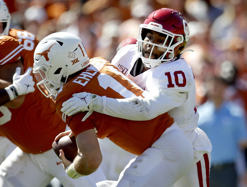 Photo - Oklahoma's Pat Fields (10) sacks Texas quarterback Sam Ehlinger (11) in the second quarter during the Red River Showdown college football game between the University of Oklahoma Sooners (OU) and the Texas Longhorns (UT) at Cotton Bowl Stadium in Dallas, Saturday, Oct. 12, 2019. [Sarah Phipps/The Oklahoman]