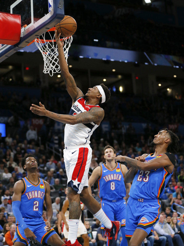 Photo - Washington's Bradley Beal (3) scores a basket past Oklahoma City's Terrance Ferguson (23), right, as Shai Gilgeous-Alexander (2) and Danilo Gallinari (8) look on in the fourth quarter during an NBA basketball game between the Oklahoma City Thunder and the Washington Wizards at Chesapeake Energy Arena in Oklahoma City, Friday, Oct. 25, 2019. The Wizards won 97-85. [Nate Billings/The Oklahoman]