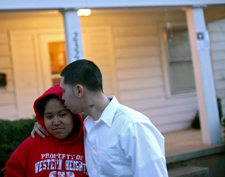 Photo -  Janet Biggers (CQ) JANET gets a kiss from her brother Corey Preciado as they talk about their mother Angela Biggers outside the family's home in northwest Oklahoma City on Monday, Dec. 20, 2010. Photo by John Clanton, The Oklahoman ORG XMIT: KOD