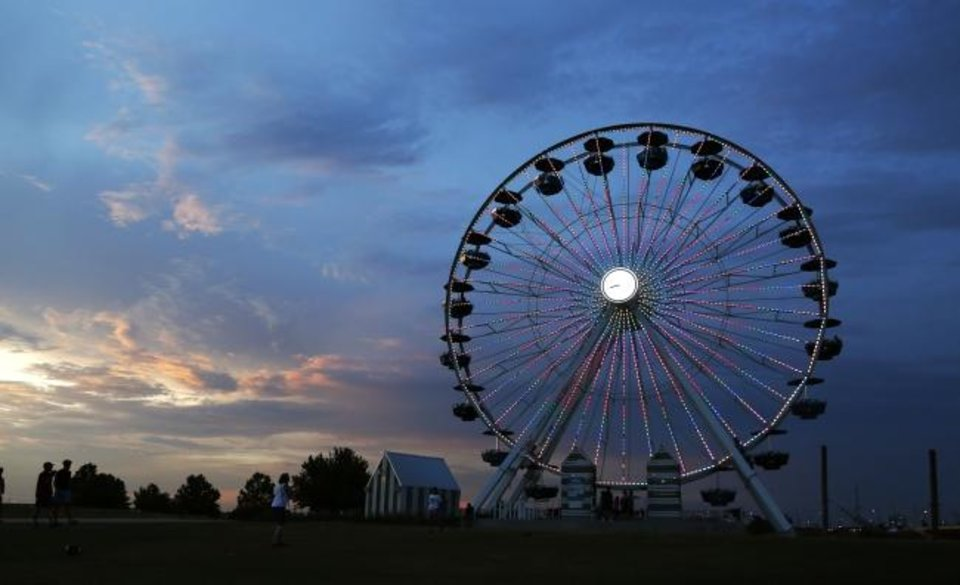 Photo -  The Ferris wheel just south of downtown Oklahoma City remains a popular attraction in its third year along the Oklahoma River.  [Paxson Haws/The Oklahoman]