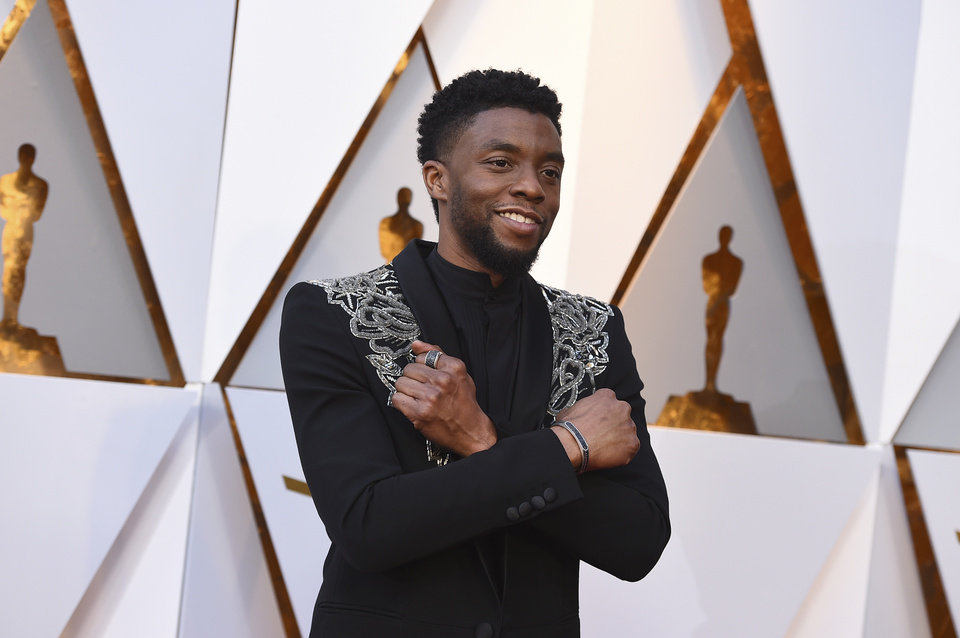 Photo - Chadwick Boseman arrives at the Oscars on Sunday, March 4, 2018, at the Dolby Theatre in Los Angeles. (Photo by Jordan Strauss/Invision/AP)