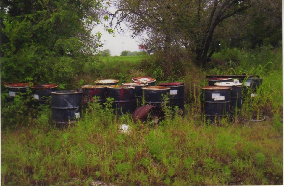 Photo -  In this undated photo, barrels of radioactive waste are seen at the former Eagle Industries, 8828 SE 29 St., in Midwest City. [Photo provided by Oklahoma Department of Environmental Quality]