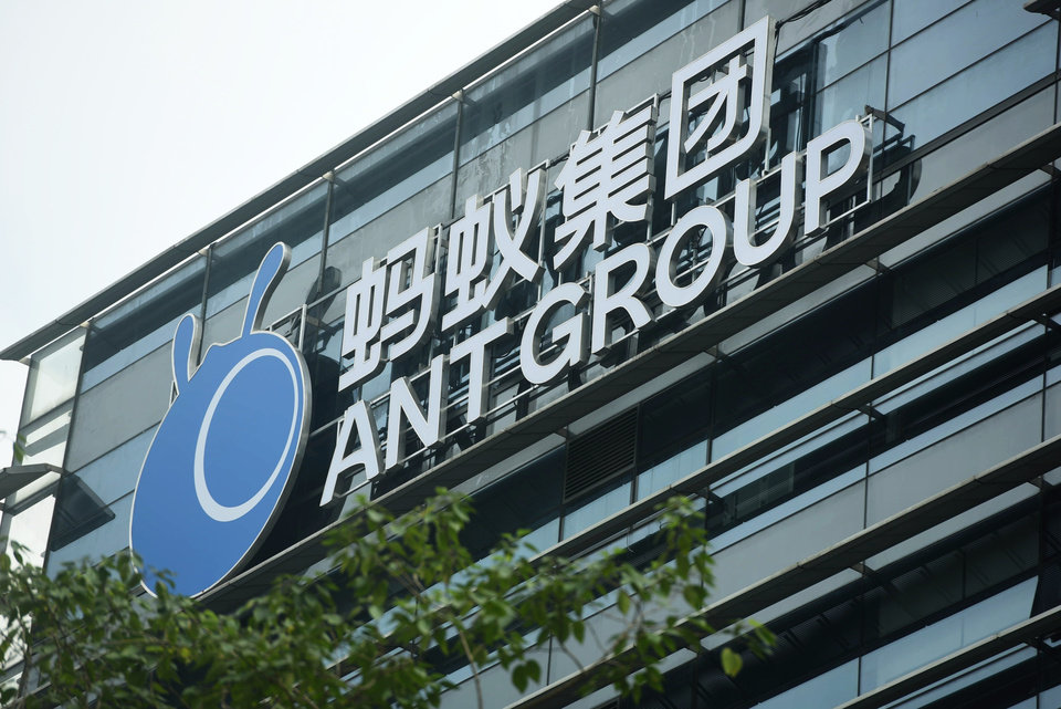 Photo -  A view of the signage of Ant Group in the headquarters compound of the fintech giant in Hangzhou in eastern China's Zhejiang province Monday, Oct. 26, 2020. Chinese regulators summoned Ant Group founder Jack Ma and two other senior executives to a meeting on Monday, Nov. 2, 2020, just days before the company's shares are due to begin trading following a blockbuster offering expected to be the world's largest.(Chinatopix Via AP)