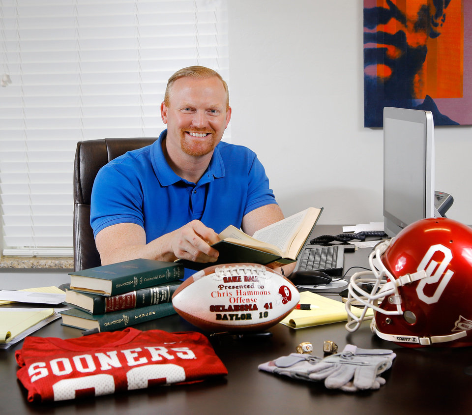 Photo -  Oklahoma City attorney Chris Hammons, managing partner of Laird Hammons Laird is in his firm's office. Hammons played on the OU football teams and was an offensive player in the 2000 Big 12 title game. [PHOTO BY JIM BECKEL, THE OKLAHOMAN]