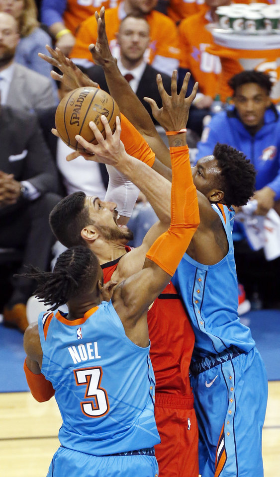 Photo - Oklahoma City's Jerami Grant (9), right, and Nerlens Noel (3) defend Portland's Enes Kanter (00) in the first quarter during Game 3 in the first round of the NBA playoffs between the Portland Trail Blazers and the Oklahoma City Thunder at Chesapeake Energy Arena in Oklahoma City, Friday, April 19, 2019. Photo by Nate Billings, The Oklahoman