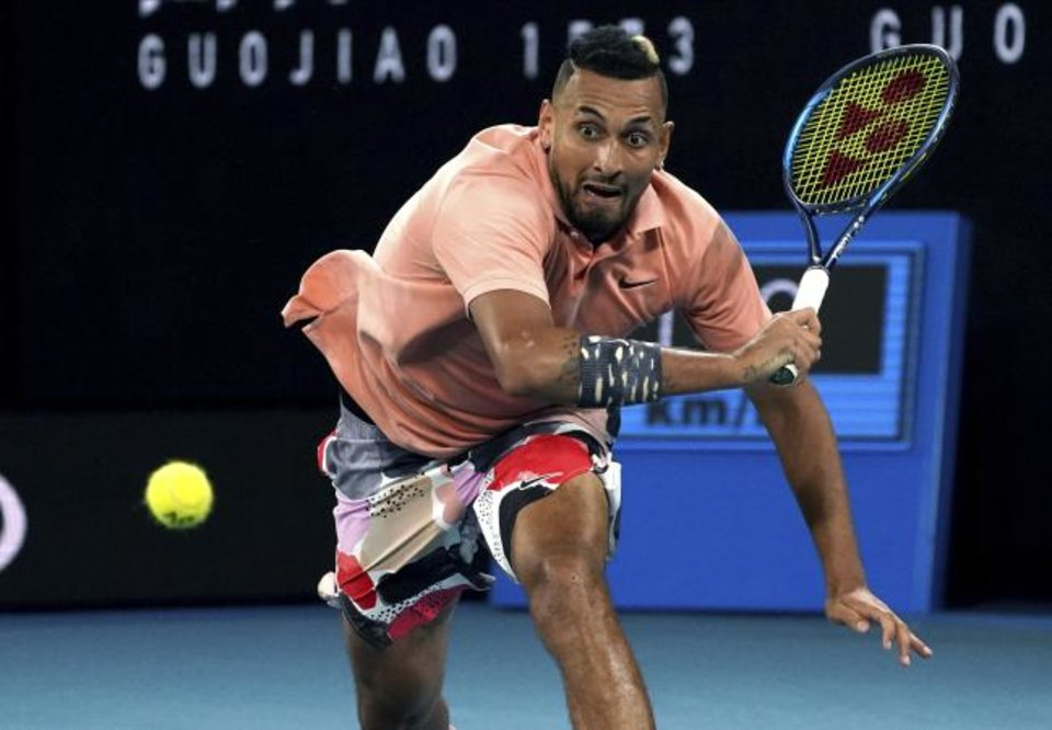 Photo -  Australia's Nick Kyrgios runs to make a backhand return to Russia's Karen Khachanov during their third round singles match at the Australian Open tennis championship in Melbourne, Australia, on Saturday. [AP Photo/Lee Jin-man]